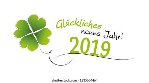 cloverleaf with german text glückliches neues jahr means happy new year