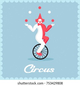 Clown rides a bicycle and juggles balls. Juggler on a unicycle
