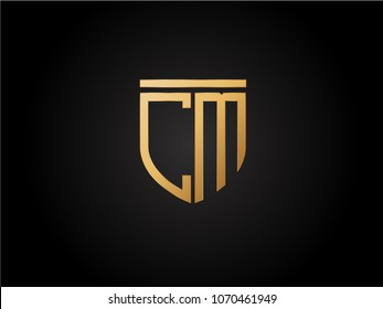 CM shield shape Letter Design in gold color
