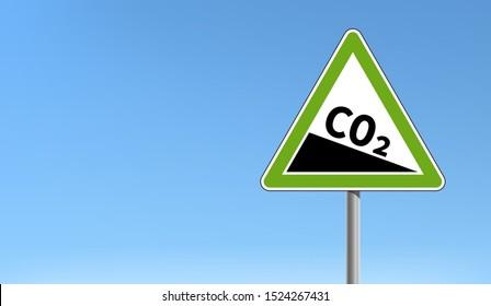 CO2 emission reduction sign green triangular shape blue sky