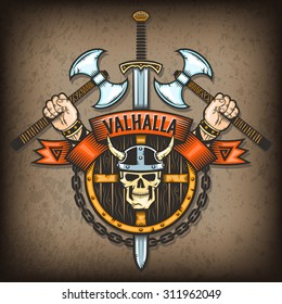 Coat of Valhalla. Vikings sign with a skull in a horned helmet on the background of the shield with axes and hand. All textures are on separate layers.