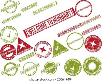 """Collection of 22 red grunge rubber stamps with text """"WELCOME TO HUNGARY"""". Vector illustration"""