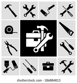 A collection of black house maintenance or renovation working tools isolated icons set of hammer wrench screwdriver and measuring tape vector illustration