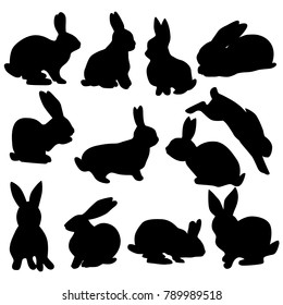 Collection of black silhouettes of rabbits isolated on a white background. Easter rabbits in various poses.