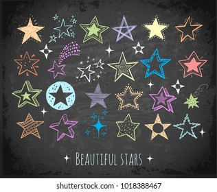 Collection of colored doodle stars on blackboard background