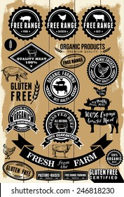 A collection of free range and organic labels on wooden background . All labels are grouped. EPS 8