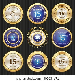 Collection of glossy gold and blue 15th anniversary badges