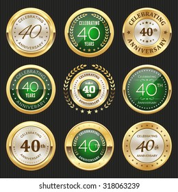 Collection of glossy gold and green 40th anniversary badges