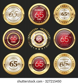 Collection of glossy gold and red 65th anniversary badges