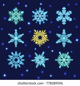 Collection of glowing neon snowflakes in line style isolated on dark background
