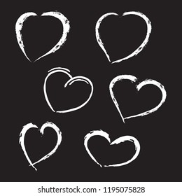 Collection of hand drawn grunge hearts made with white chalk on the blackbord. Unique vector symbols for romantic message.