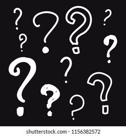Collection of hand drawn question mark with dark background