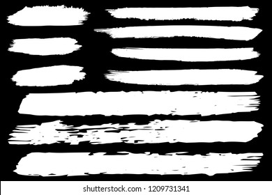 Collection of hand drawn white grunge brushes. Vector Grunge Brushes. Dirty Artistic Design Elements. Creative Design Elements. Black background. Distress Frame, Logo, Banner, Wallpaper.