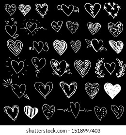 Collection of hearts in a hand draw style. White hearts contour on a black background. Chalk drawing on a black board. Set of design elements for valentines day