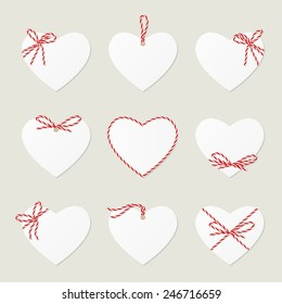 Collection of hearts with red ribbons ahd bows in twine style with space to your text