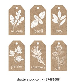 Collection of  kraft paper tags with culinary herbs and spices.
