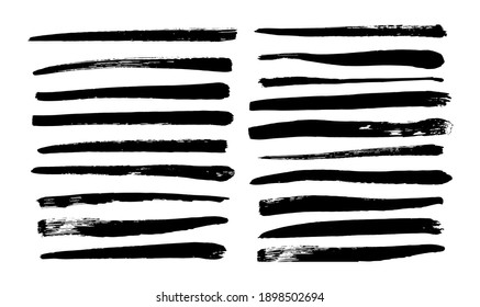 Collection of long black brush strokes drawn by hand. Vector illustration isolated on white background.