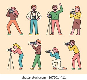 A collection of photographer characters in various poses. flat design style minimal vector illustration.