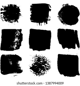 Collection of spots, brush strokes in grunge style. Monochrome abstract blots on white background