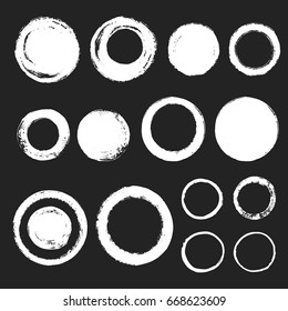 Collection of various chalk or brush drawn circles. Set of graphic elements. Round hand drawn different frames or brush strokes with rough, uneven edges.