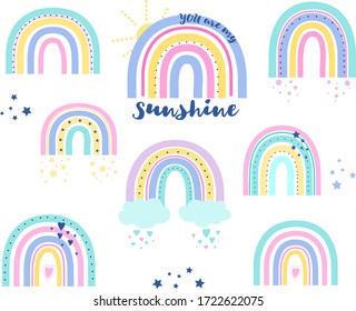 Collection of vector rainbows with text. Rainbow with clouds.