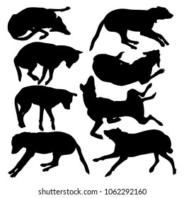 Collection of vector silhouettes of dogs lying in different poses isolated on white background. A lazy dog sleeps on the floor.