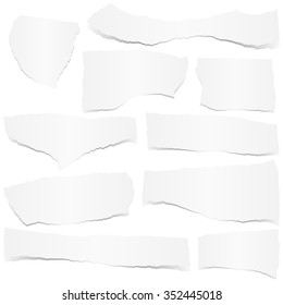 collection of white colored scraps of papers with shadow