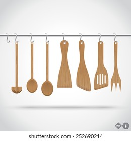 A collection of wooden kitchen utensils hanging on the chromed bar. Illustratio