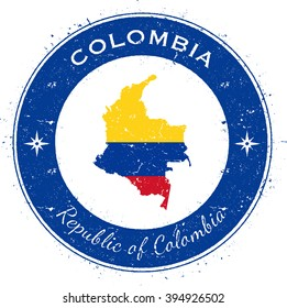 Colombia patriotic badge. Grunge rubber stamp with national flag, map and the Colombia written along circle border. Patriotic badge of Colombia vector illustration.