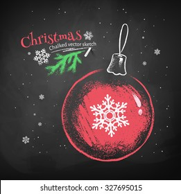Color chalk vector sketch of red Christmas ball with snowflake on black chalkboard background.