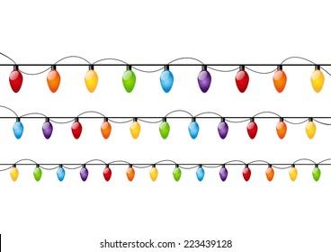Color Christmas light bulbs on white