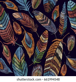 Color feathers embroidery seamless pattern. Beautiful feathers of tropical birds classic embroidery seamless background. Fashionable template for design of clothes, t-shirt design