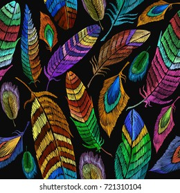 Color feathers embroidery seamless pattern. Fashionable template for design of clothes, t-shirt design. Beautiful feathers of tropical birds fashion embroidery seamless background