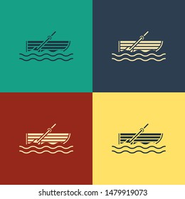 Color Fishing boat with oars on water icon isolated on color background. Vintage style drawing. Vector Illustration
