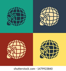 Color Globe with flying plane icon isolated on color background. Airplane fly around the planet earth. Aircraft world icon. Vintage style drawing. Vector Illustration