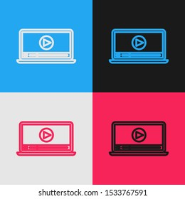 Color line Online play video icon isolated on color background. Laptop and film strip with play sign. Vintage style drawing. Vector Illustration