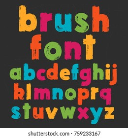 Color lowercase handwritten vector alphabet on black background. Drawn by semi-dry brush with unpainted areas.