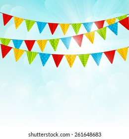 Color party flags on sunny background