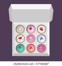 Colored cupcakes set in the box. Top view.