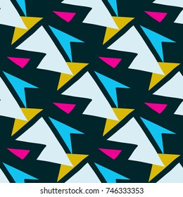 colored polygons on a dark background seamless geometric pattern
