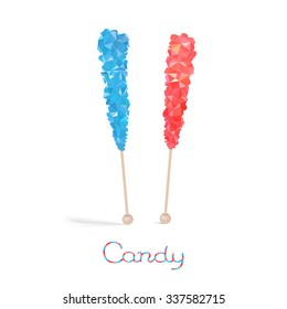 Colored rock candy lollipops on the stick isolated on white background