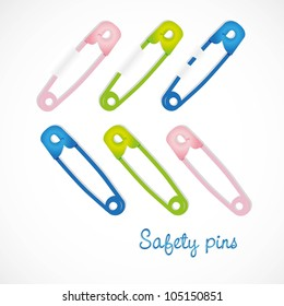 colored safety pins, isolated on white background