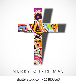 Colorful abstract decorated Christian Cross on abstract grey background for Merry Christmas celebration.