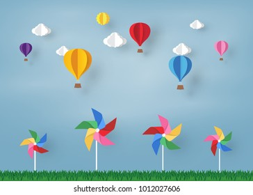 colorful Ballon and Cloud in the  blue sky and pinwheel with paper art design , vector design element  and illustration