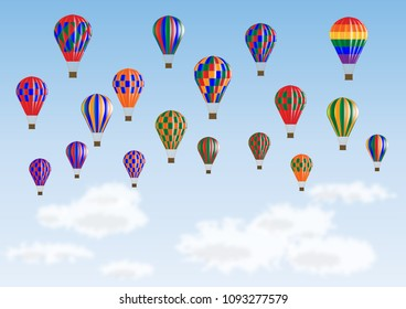 Colorful balloons in flight over the clouds against blue sky