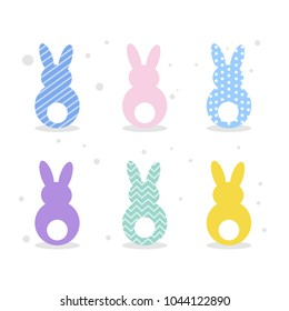 Colorful and bright Easter rabbits set on white.