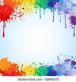 Colorful bright ink splashes on blue background