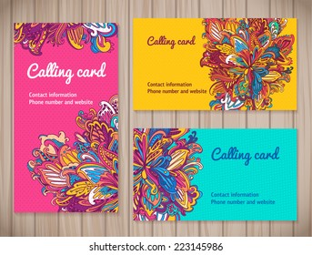 Colorful Business Cards template in different floral styles. vector floral business card set on wood background.