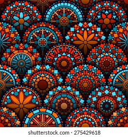 Colorful circle flower mandalas geometric seamless pattern in blue red and orange, vector