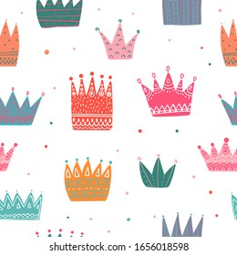 Colorful crowns seamless pattern. Tiaras repeated print. Girlish repeat ornament for fashion textile, clothes, wrapping paper. Princess elements